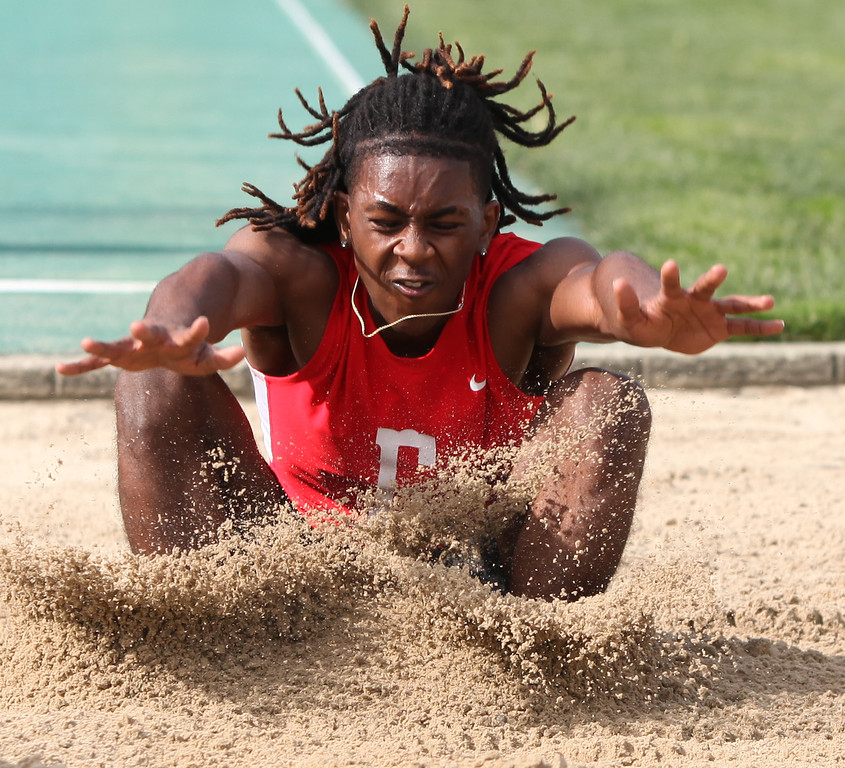 . Randy Meyers - The Morning Journal<br> Ty\'Jhon Allgood of Elyria lands his attempt in the boys long jump on May 16.
