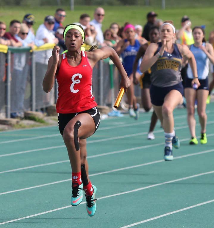 . Randy Meyers - The Morning Journal<br> Elyria\'s JaMaya Ward takes the lead during the first heat of the girls 4x100 meter relay on May 16.