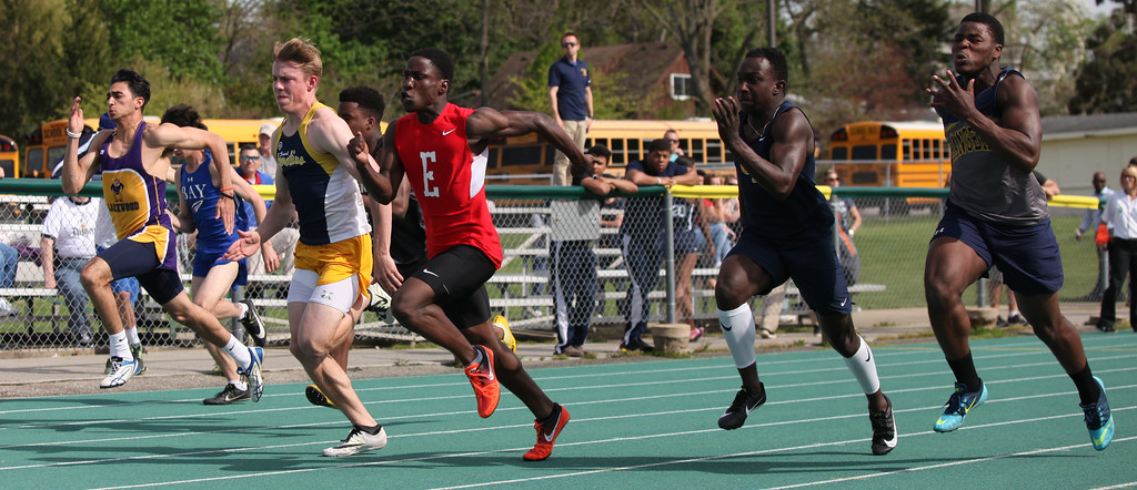 . Randy Meyers - The Morning Journal<br> Runners compete in the boys 100 meter dash on May 16.
