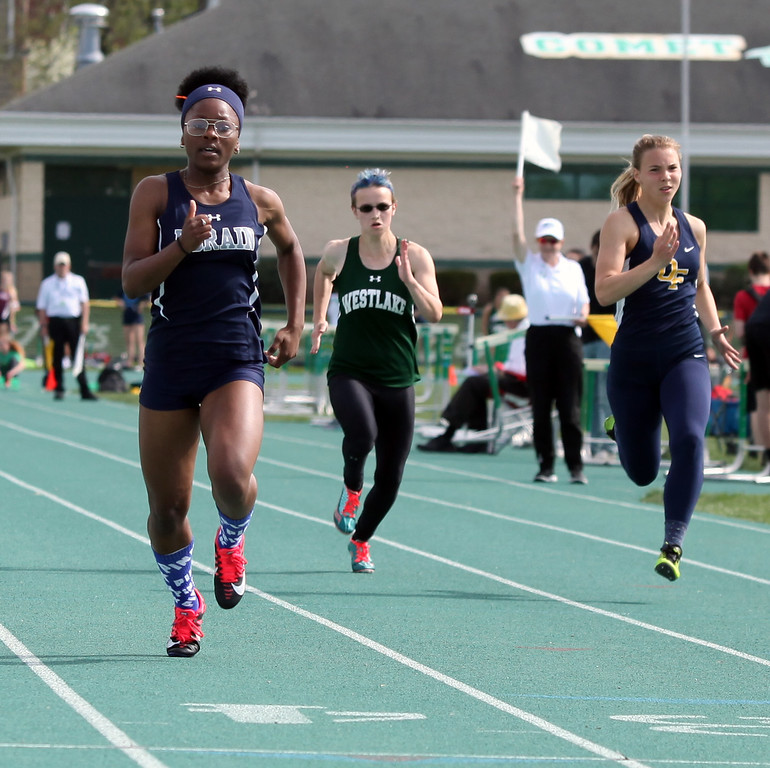 . Randy Meyers - The Morning Journal<br> Mikiya Hermon of Lorain won the girls first heat of the 100 meter dash on May 16.