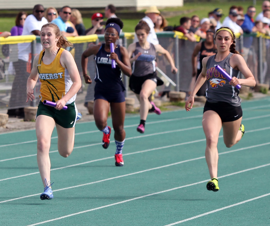 . Randy Meyers - The Morning Journal<br> Anna Dudziak of Amherst and Sanrae Jones of Avon are even during the last leg of the girls 4x100 relay on May 16.