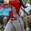 Elyria's Madison Cruzado fouls off a pitch against Amherst. Randy Meyers -- The Morning Journal