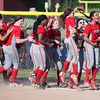 Elyria's softball team celebrates after winning the district final on Wednesday over Amherst. Randy Meyers -- The Morning Journal