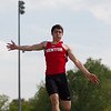 Michael Johnson - The News-Herald<br /> Jack Berrow of Mentor performs in the long jump event during day one of the D1 District Track Meet at Mayfield High School on May 17, 2017.