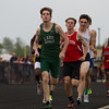 Michael Johnson - The News-Herald<br /> Runners race in the boys 4x800 meter relay during day one of the D1 District Track Meet at Mayfield High School on May 17, 2017.