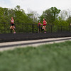 Michael Johnson - The News-Herald<br /> Runners turn the corner in the girls 4x800 meter relay during day one of the D1 District Track Meet at Mayfield High School on May 17, 2017.