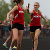 Michael Johnson - The News-Herald<br /> Mentor's Anna Evans passes the baton to Emma Lane in the 4x800 meter relay during day one of the D1 District Track Meet at Mayfield High School on May 17, 2017.