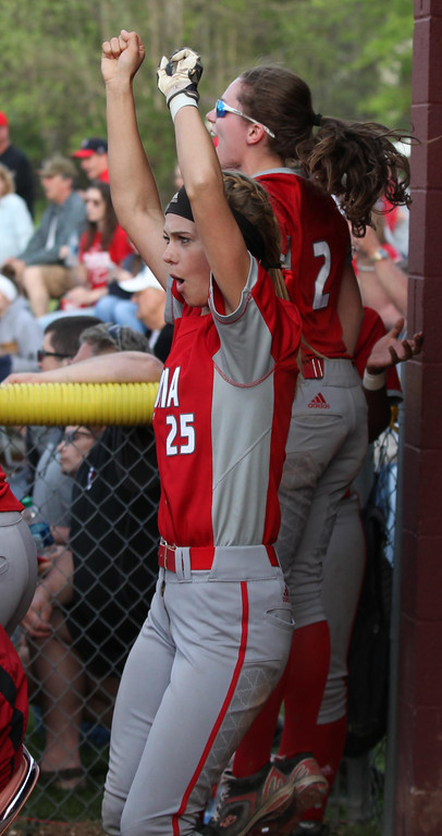 . Randy Meyers - The Morning Journal Elyria\'s April Howser and Macy Taylor celebrate a run scored against Amherst on Thursday