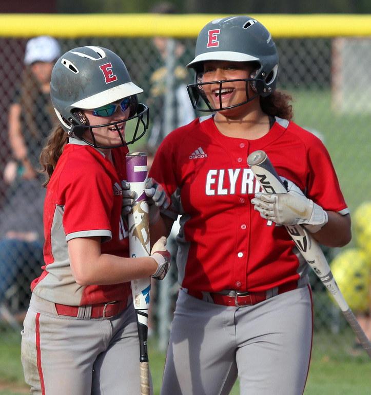 . Randy Meyers - The Morning Journal Maycee Godbolt (right)  congratulates Macy Taylor after she scores against Amherst on Thursday at  the District I finals