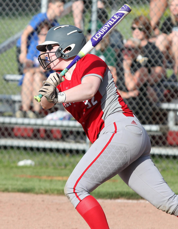 . Randy Meyers - The Morning Journal Cassie Miller of Elyria lines a hit  against Amherst on Thursday