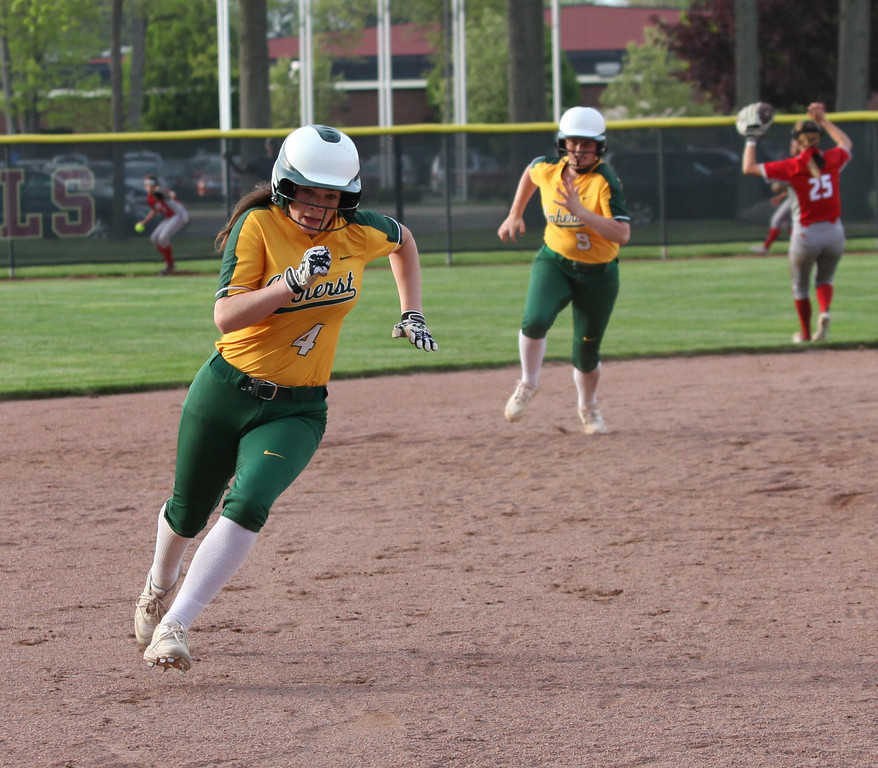 . Randy Meyers - The Morning Journal Lindsey Reavis of Amherst runs to  third and will score against Elyria on Thursday