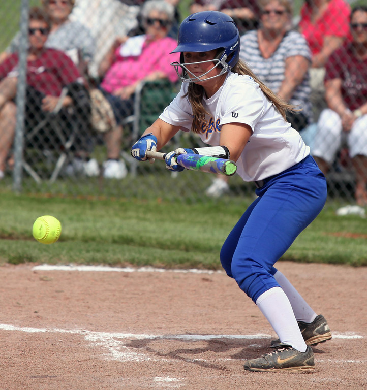 . Randy Meyers - The Morning Journal Sophia Trembetta puts a bunt down  against Wellington during the District III finals on Thursday