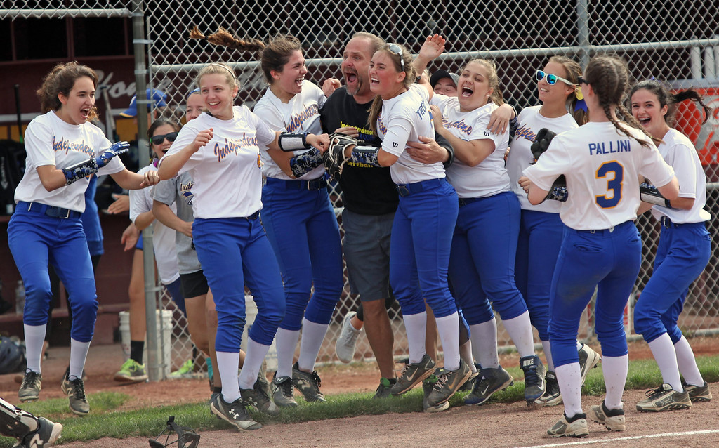 . Randy Meyers - The Morning Journal Independence head coach Garry Moore  is mobbed by his softball team after they defeated Wellington in the  District III finals on Thursday