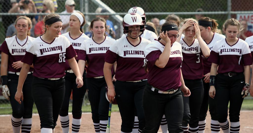 . Randy Meyers - The Morning Journal A dejected Wellington softball team  walks off the field after losing to Independence on Thursday