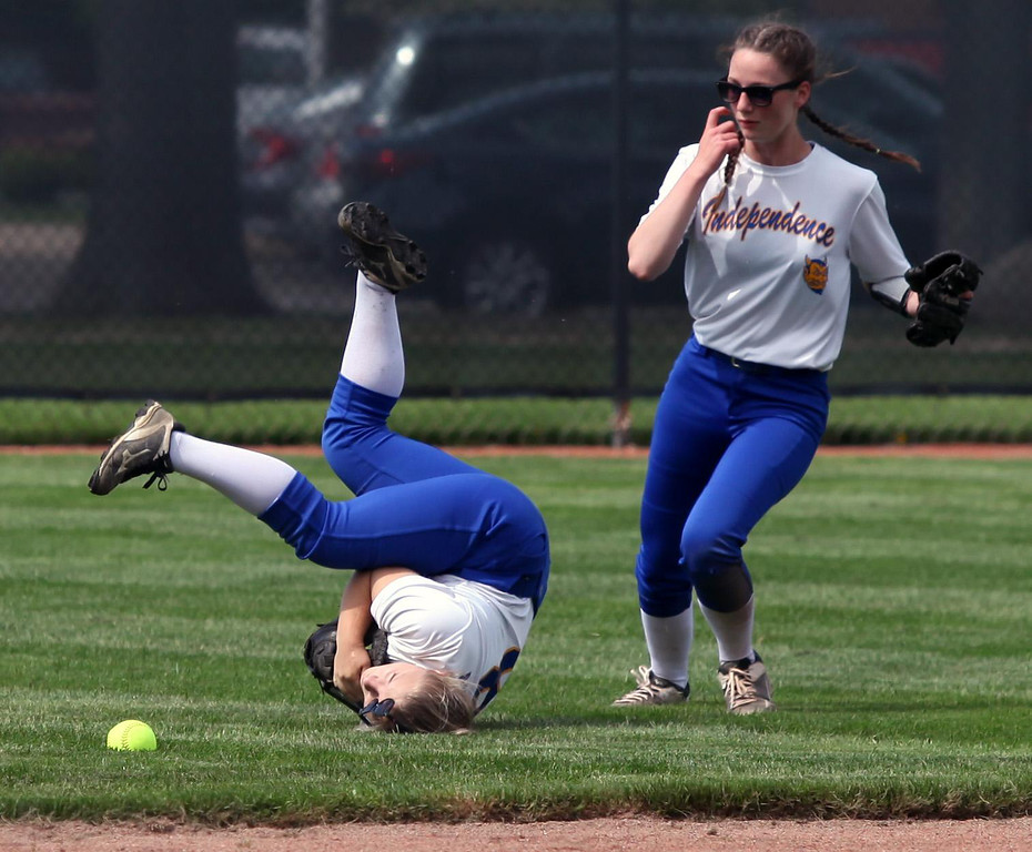 . Randy Meyers - The Morning Journal Independence center fielder Elise  Nelson dives for a fly ball and flips in front of Olivia Pallini against  Wellington on Thursday