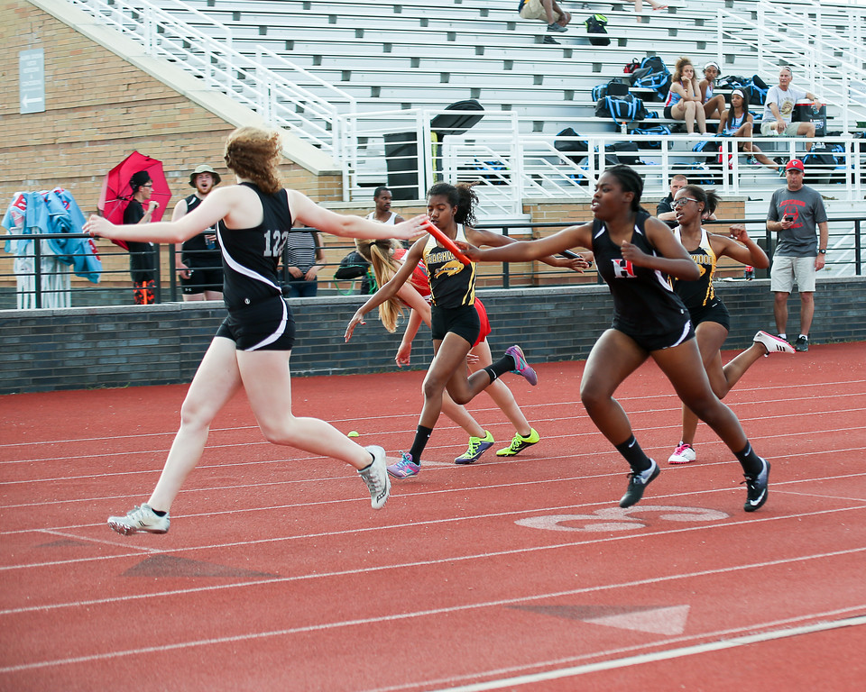 . Coleen Moskowitz - The News-Herald The Hawken 4x200 relay.