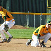 Jon Behm - The Morning Journal<br /> Amherst sophomore Ryan Glowacki, left, prepares to fire to first as junior Brian D'Andrea ducks out of the way during the bottom of the third inning against Avon during the Division I Lorain District final on May 19 at The Pipe Yard.