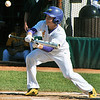 Jon Behm - The Morning Journal<br /> Avon senior Will Heilman pops up a bunt attempt during the bottom of the second inning against Amherst during the Division I Lorain District final on May 19 at The Pipe Yard.