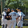 Jon Behm - The Morning Journal<br /> Avon's infield has a meeting at the mound.