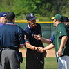 Jon Behm - The Morning Journal<br /> Avon coach Frank DeSmit, left, and Amherst coach Matt Rositano, front right, meet with the umpires prior to the Division I Lorain District final on May 19 at The Pipe Yard.