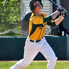 Jon Behm - The Morning Journal<br /> Amherst sophomore Evan Shawver watches a pop up during the top of the third inning against Avon during the Division I Lorain District final on May 19 at The Pipe Yard.