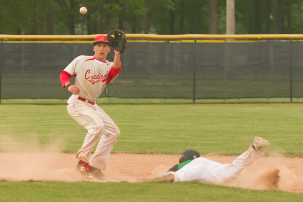 . Barry Booher - The News-Herald Mentor\'s Nick Smith, gathers the throw as Mayfield\'s Luke Razzante steals second.