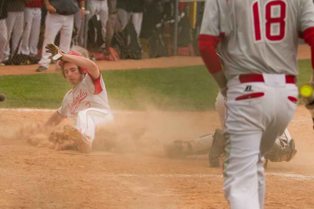 . Barry Booher - The News-Herald Mentor\'s Tyler Knapp slides home , scoring from second on a hit.