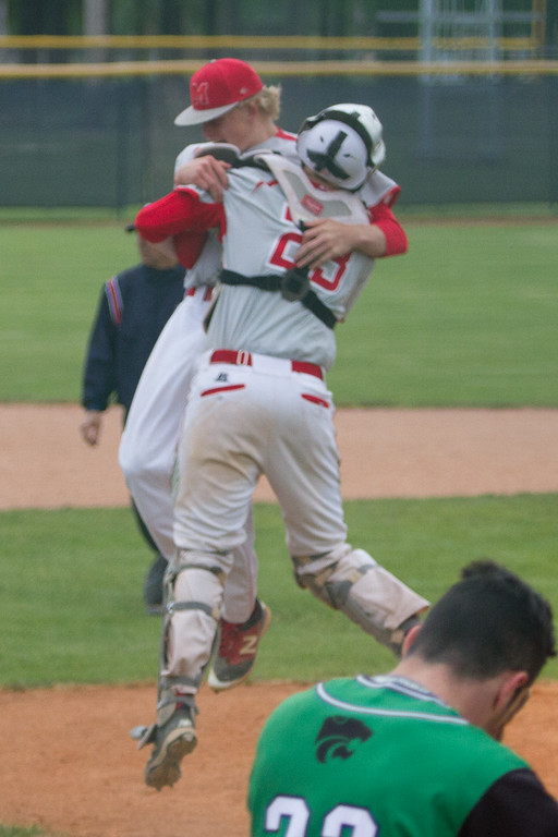 . Barry Booher - The News-Herald Catcher Tommy Noll celebrates with Squire Chapman.