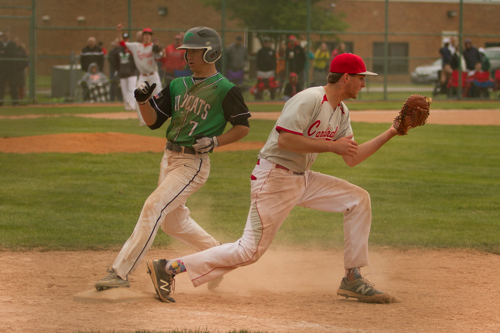 . Barry Booher - The News-Herald Mentor first baseman Matt Detering forces out Joseph Trivison.