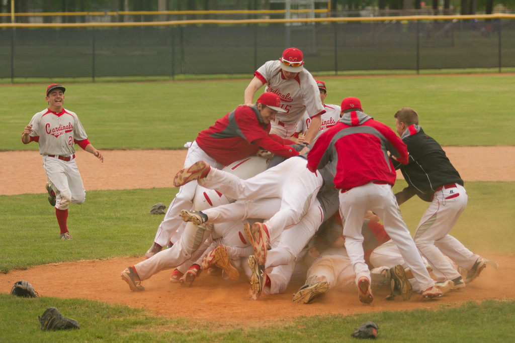 . Barry Booher - The News-Herald The Mentor baseball team celebrates its district title win on May 19.
