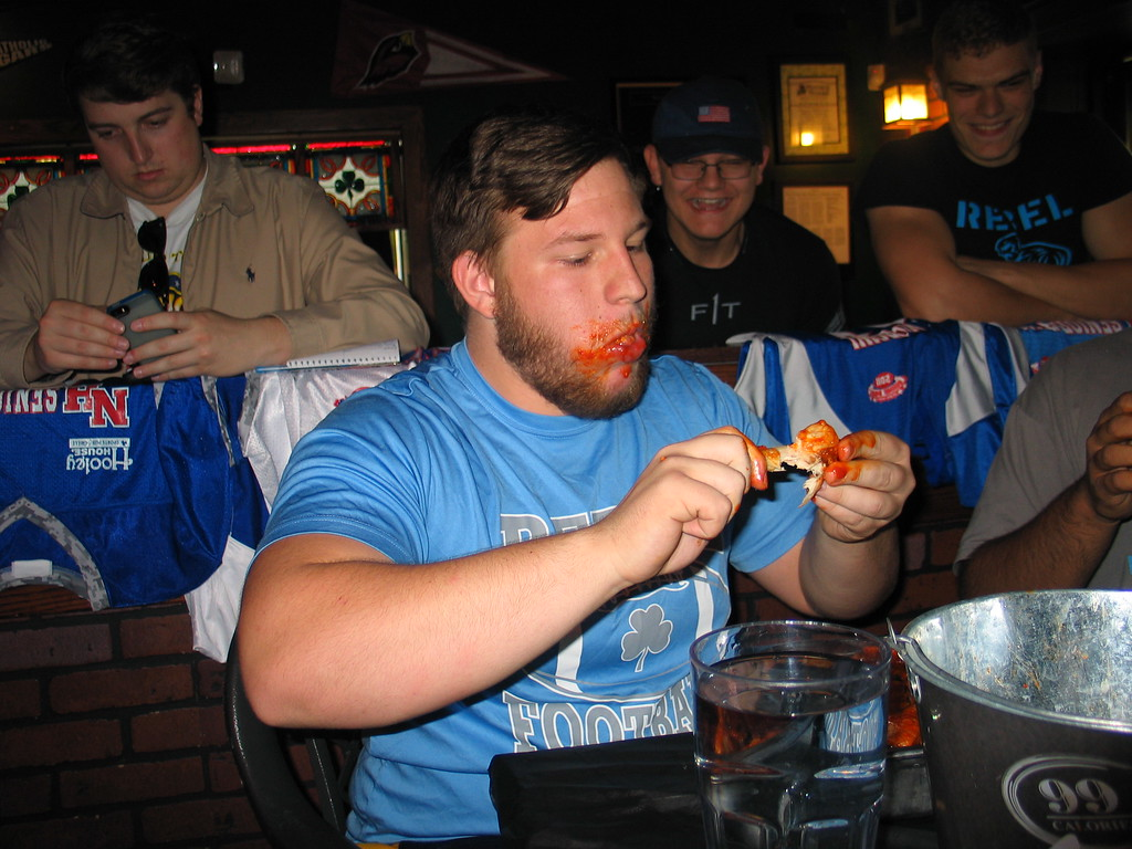 . John Kampf - The News-Herald South\'s Sean Scherl at the 2017 News-Herald Senior Bowl wing-eating contest on May 22 at Hooley House in Mentor.