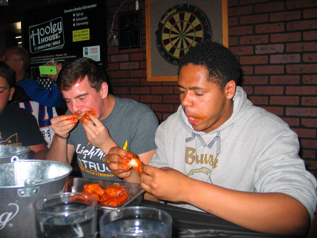 . John Kampf - The News-Herald Brush\'s Nick Loya and Ray Stewart at the 2017 News-Herald Senior Bowl wing-eating contest on May 22 at Hooley House in Mentor.