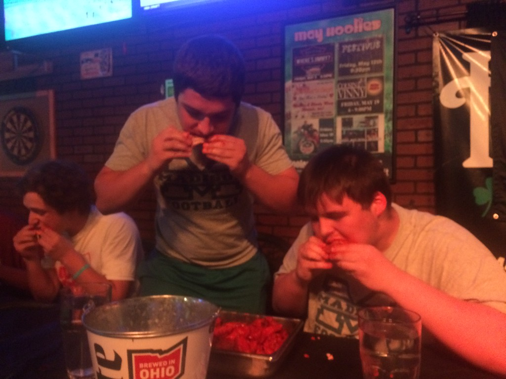 . John Kampf - The News-Herald Madison\'s Clay Smith and Jake Glass, at the 2017 News-Herald Senior Bowl wing-eating contest on May 22 at Hooley House in Mentor.