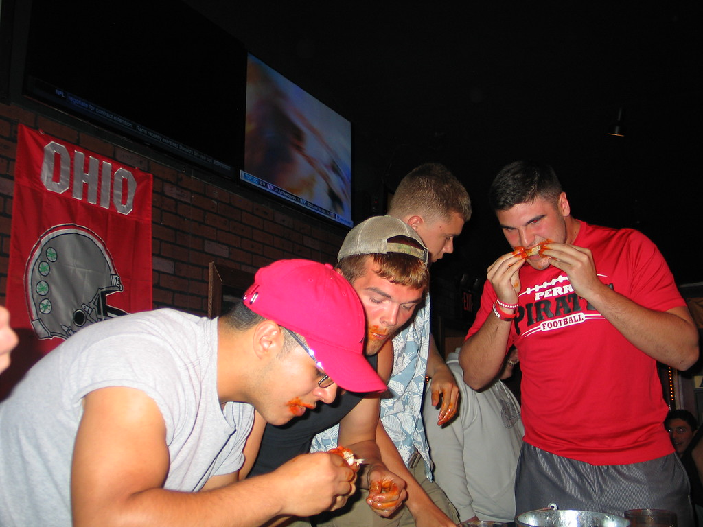 . John Kampf - The News-Herald Left to right, Geneva\'s Juan Rodriguez and Kody Brown and Perry\'s Ryan Burko and Hayden Makad at the 2017 News-Herald Senior Bowl wing-eating contest on May 22 at Hooley House in Mentor.