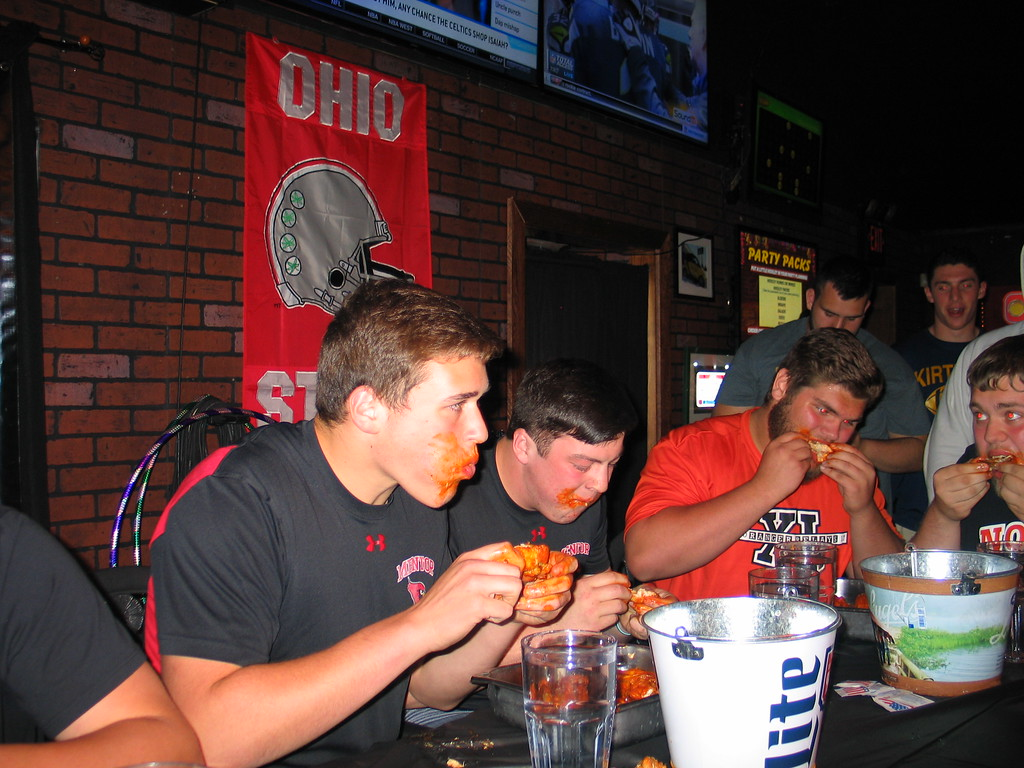 . John Kampf - The News-Herald Mentor\'s Ryan Jacoby and Tyler Churney and North\'s Joe Ginter and Mark Fonovic, at the 2017 News-Herald Senior Bowl wing-eating contest on May 22 at Hooley House in Mentor.