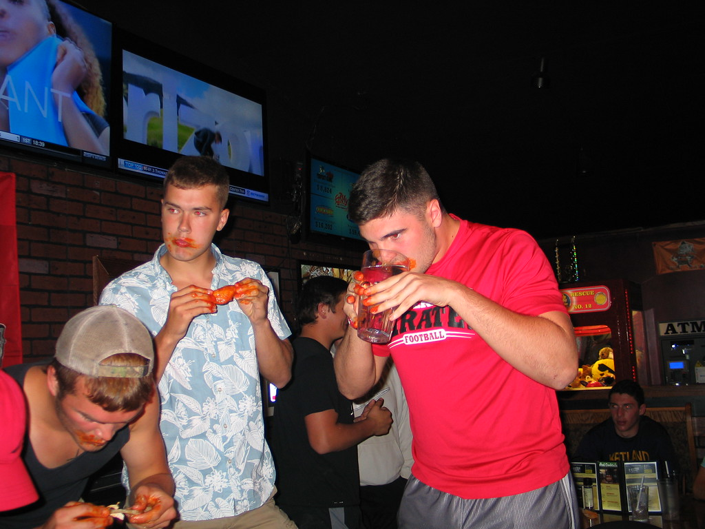 . John Kampf - The News-Herald Standing, Perry\'s Ryan Burko and Hayden Makad at the 2017 News-Herald Senior Bowl wing-eating contest on May 22 at Hooley House in Mentor.
