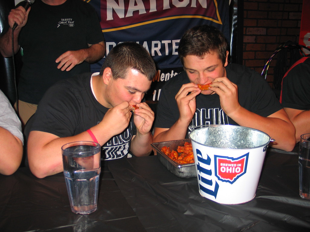 . John Kampf - The News-Herald Kirtland Brett Diemer and Jack Bailey, at the 2017 News-Herald Senior Bowl wing-eating contest on May 22 at Hooley House in Mentor.