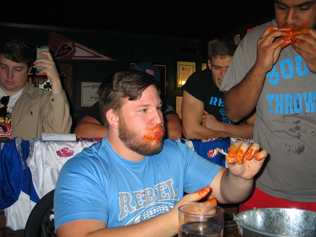 . John Kampf - The News-Herald South\'s Sean Scherl, left, and Jitesh Patel, at the 2017 News-Herald Senior Bowl wing-eating contest on May 22 at Hooley House in Mentor.