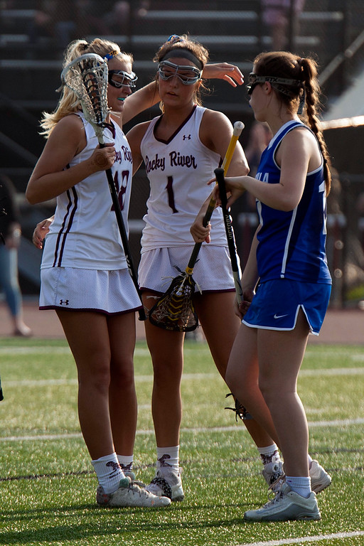 . Jen Forbus - The Morning Journal<br> Rocky River\'s Hailey Kristoff, left, congratulates Olivia Schumacker  on a goal against the Toledo St. Ursula Arrows on May 22. Rocky River won, 15-5.