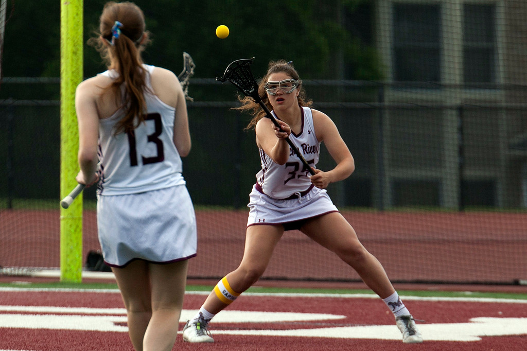 . Jen Forbus - The Morning Journal<br> Rocky River\'s Emmy St. Pierre (35) receives a pass from teammate Sam Miller against Toledo St. Ursula on May 22.