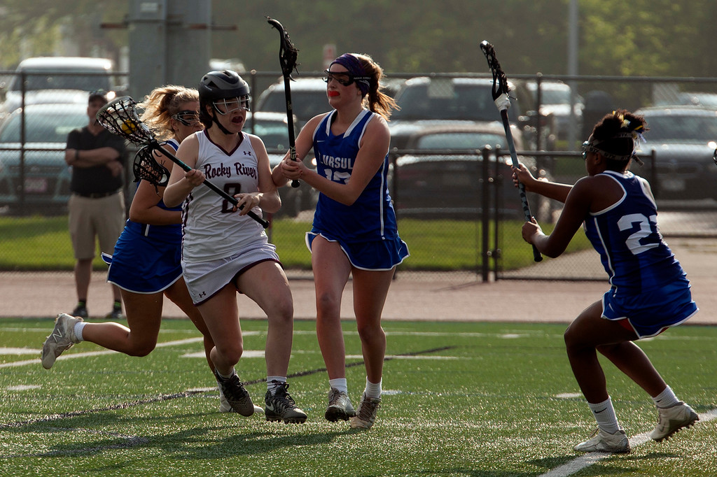 . Jen Forbus - The Morning Journal<br> Lauren Cain of Rocky River has possession of the ball surrounded by Toledo St. Ursula\'s defense on May 22.