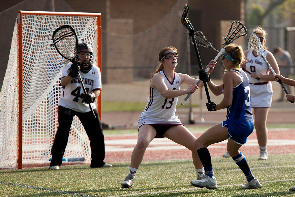 . Jen Forbus - The Morning Journal<br> Sam Miller of Rocky River adds a layer of defense between Toledo St. Ursula\'s Bridgette Lay and Rocky River goal keeper Jacque Pappadakes on May 22.
