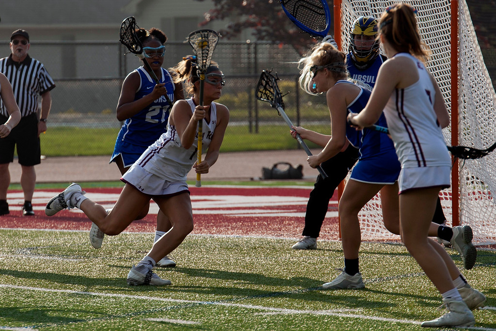 . Jen Forbus - The Morning Journal<br> Rocky River\'s Olivia Schumacker heads for the goal against Toledo St. Ursula in a Division II, Region 5 semifinal contest on May 22.
