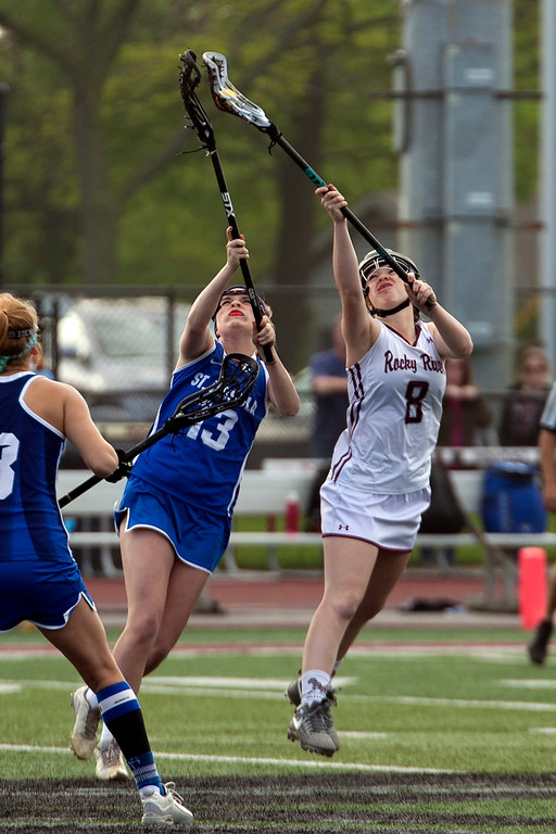 . Jen Forbus - The Morning Journal<br> Rocky River\'s Lauren Cain vies for possession of the ball with Toledo St. Ursula\'s Kate Hopkins on May 22.