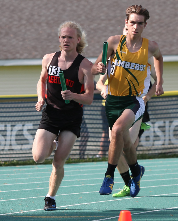 . Randy Meyers - The Morning Journal<br> Devin Baumgartner of Amherst and Josh Mendenhall of Ashland are even during the second lap of the 4x 800 meter relay on May 23.
