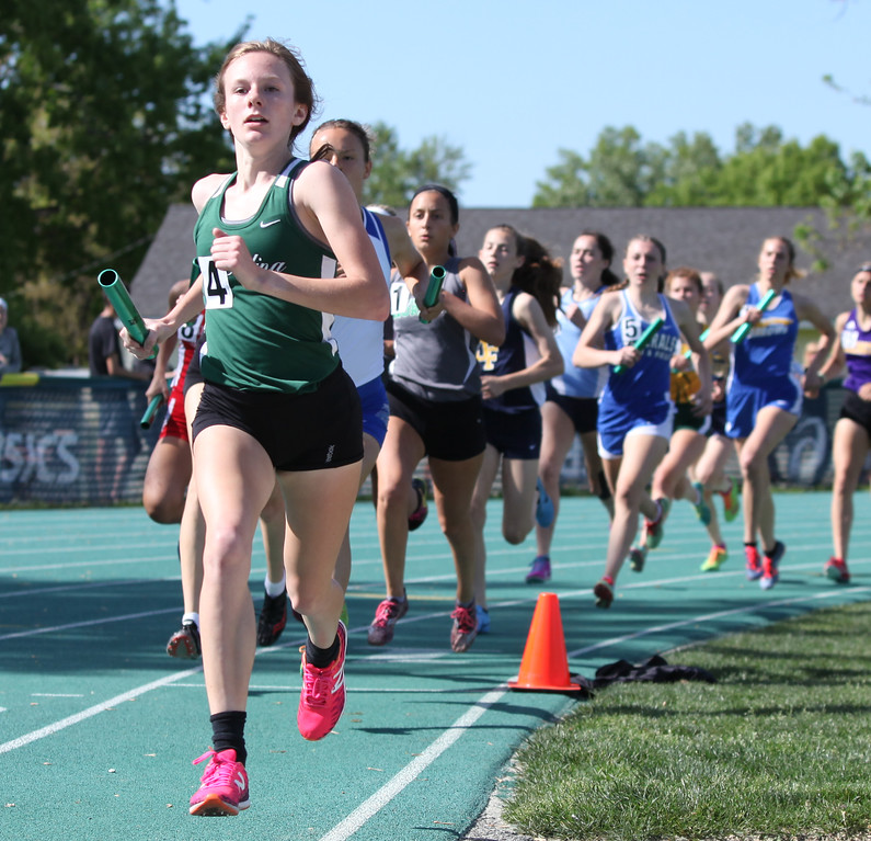 . Randy Meyers - The Morning Journal<br> Carmela Henning of Medina has the lead during the first lap of the 4x800 meter relay on May 23.