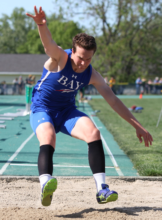 . Randy Meyers - The Morning Journal<br> Jared Riess of Bay makes his first attempt in the long jump at the Division I Amherst regional on May 23.