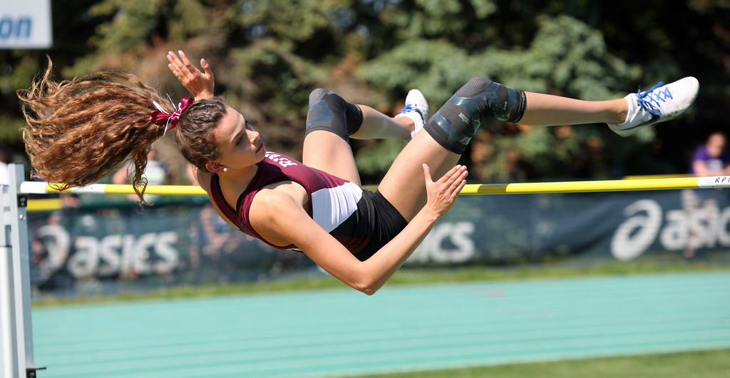 . Randy Meyers - The Morning Journal<br> Rocky River\'s Ava Rauser clears the bar in her first attempt in the high jump at the Division I Amherst regional on May 23. Rauser would clear 5-foot-4 to place third and qualify for state.