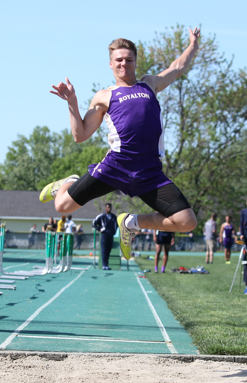 . Randy Meyers - The Morning Journal<br> Bradley Kmetz of North Royalton makes his first attempt in the long jump at the Division I Amherst regional on May 23.