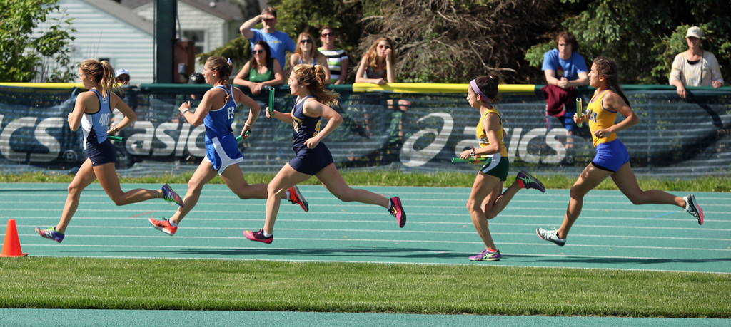 . Randy Meyers - The Morning Journal<br> Runners make the first turn during the girl\'s 4x800 meter relay at the Division I Amherst regional on May 23.